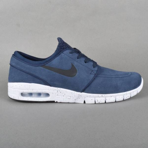 max l features nike sb janoski max solid suede upper free run sole air